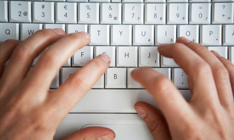 Hands Writing On A Computer Keyboard Close-up.